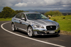 The Jaguar XF, which took more than 50 hours to &quot;wrap&quot;, has certainly grabbed people's attention since it hit the roads in Auckland. Photo / Ted Baghurst