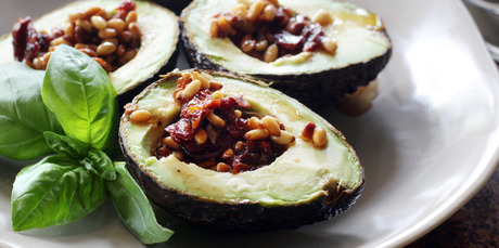 Pinenuts and sundried tomatoes add interest to avocados, served with Mediterranean dressing. Photo / Doug Sherring