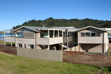 The newly-built beachfront property has a downstairs flat and good north-facing views.