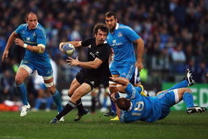 Man of the match Conrad Smith offloads during a commanding performance in the Italy test at Stadio Olimpico.  Photo / Getty Images