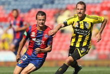 Ryan Griffiths of the Jets and Andrew Durante of the Phoenix during the round seven A-League match. Photo / Getty Images