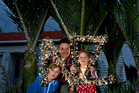 Justin Newcombe with his Christmas tree lights project, accompanied by his children, Jasper and Grace. Photo / Sarah Ivey
