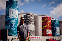 Elliot O'Donnell, also known as Askew One, has painted eight tanks featuring CK Stead's Auckland. Photo / Dean Purcell