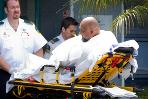 A survivor of the boating accident is transferred to an ambulance at the Marine Rescue Centre at Mechanics Bay. Photo / Sarah Ivey