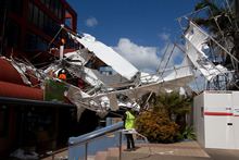 Plastic-wrapped scaffolding collapsed between twoTakapuna buildings during high winds yesterday.  Photo /  Sarah Ivey