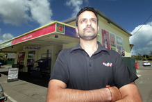 Vinod Meghwal, manager of the St John Four Square Supermarket, was still shaken yesterday after the armed holdup. Photo / Stuart Munro