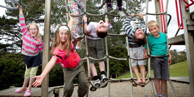 Kauri Park students (from left) Isobelle Masters, 9, Isabella Lundberg, 10, Stella-Rose Pirie-Marsters, 11, Alex Gordon, 10, Emily Nebbling, 11, William Hawkins, 9, and James Potter, 9, were among 700 Kiwi kids who took part in a global survey of children. Photo / Natalie Slade