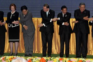 The gathered leaders perform a group handshake in Phnom Penh Cambodia. Photo / Alan Gibson