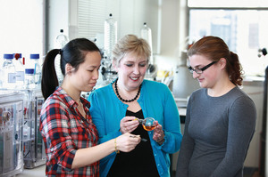 Professor Margaret Brimble (centre) says working with students like Tsz Ying Yuen (left) and Orla Finch is the reason she comes to work each day. Photo / Supplied