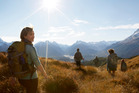 Tourism NZ advertisements appearing around the world make a clear connection with the Hobbit movies. Compare this image of tourists in New Zealand with the one below ... Photo / Supplied