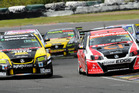 Greg Murphy and Scott McLaughlin do battle in the New Zealand V8 SuperTourers. Photo / Geoff Ridder