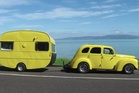 Sandra Hurley from Waihi Beach saw the yellow smart car towing the caravan in Sideswipe earlier this week and sent in a picture of her own canary combo. Photo / Supplied