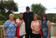 Kim Dotcom, centre, welcomed guests with bubbly. Photo / Supplied 