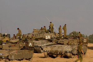 Israeli soldiers gather with their tanks and bulldozers in a gathering area near the Israel Gaza Strip border, in southern Israel. Photo / AP