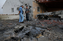 Two people were hurt when a rocket fired from Gaza hit the community of Ofakim in southern Israel. Photo /  AP