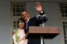President Barack Obama waves as he embraces Myanmar opposition leader Aung San Suu Kyi. Photo / AP