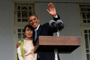 President Barack Obama waves as he embraces Myanmar opposition leader Aung San Suu Kyi. Photo / AP