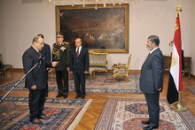 President Mohammed Morsi, right, swears in his new Prosecutor General, Talaat Abdullah. Photo / AP