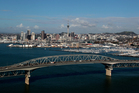 Painting Auckland's Harbour Bridge a colour other than grey could brighten motorists' days. Photo / NZ Herald