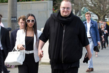 Internet billionaire Kim Dotcom and his wife Mona leaving after attending question time in parliament.Photo / File 