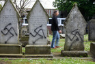 City Jewish graves were tagged with spray paint. Photo / Chris Gorman