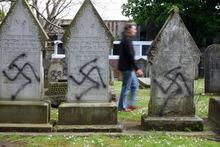 City Jewish graves were tagged with spray paint. Photo / Chris Gorman