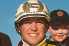 Dexter Dunn hopes his 1000th winner will be for Carter Dalgety's (right) father, trainer Can Dalgety. Photo / NZPA