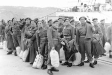 Soldiers on a wharf alongside Wahine ferry, on their embark to Korea. Photo / File