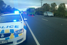Police at the scene of the accident where the woman was hit by a bus during Toast Martinborough. Photo / Tessa Johnstone
