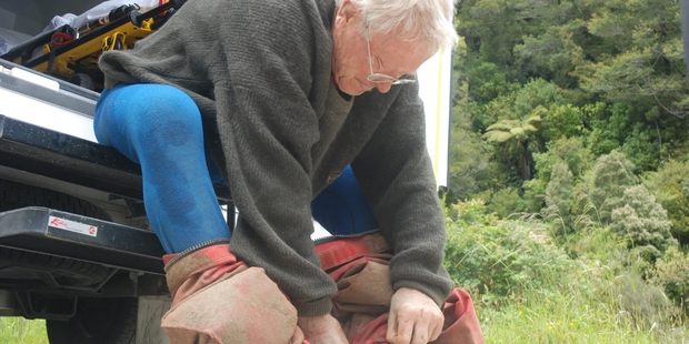 Exhausted caver Dereck Lipyeat, 82, of Christchurch, rests his weary bones on the step of an ambulance after being rescued from a limestone cave near Punakaiki this afternoon.  Photo / Greymouth Star