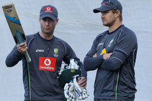 Michael Clarke talks to Shane Watson during an Australian training session. Photo / Getty Images