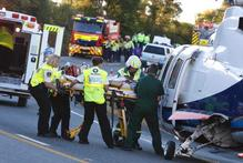 Ambulance crew attend to one of the victims involved in the fatal crash between Whangarei and Kawakawa. Photo / APN