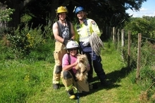 Volunteer Eketahuna firefighters, from left, Johan van Vliet, acting fire chief Max Mayer, and Ryan Seator, who plucked Australian terrier Fergie from his four-day perch.