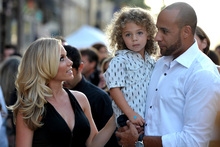 Kendra Wilkinson, left, son Hank Baskett IV, and husband Hank Baskett. Photo/AP