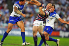 Sonny Bill Williams performs a shoulder charge tackle during his Bulldogs playing days. Photo / Getty Images