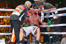 Shane Cameron is seen to by his trainers during his world title bout against Danny Green. Photo / Getty Images