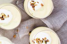 Fresh mango soup with coconut and pistachios. Photo / Babiche Martens