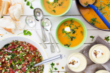 Clockwise top right: Carrot, orange and paprika soup; fresh mango soup with coconut and pistachios; and Portuguese gaspacho. Photo / Babiche Martens