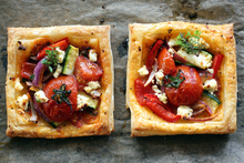 Easy tomato & feta tarts. Photo / Doug Sherring