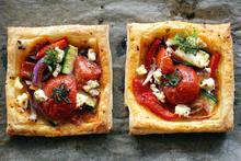 Easy tomato & feta tarts. Photo / Doug Sherring