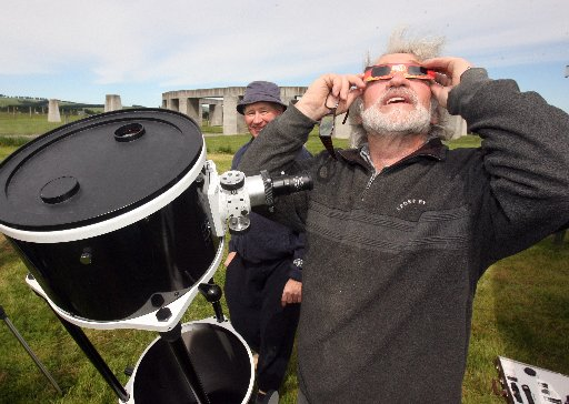 HEAVENS ABOVE: Geoff Dobson (at back) and Richard Hall with some of the hi-tech gear used to hone in on the event. PHOTO/LYNDA FERINGA