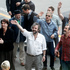 Sir Peter Jackson and The Hobbit cast wave after their photo call at Wellington Intenational Airport. Photo / Mark Mitchell