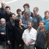 Sir Peter Jackson and The Hobbit cast pose with Air NZ staff during their photo call at Wellington International Airport. Photo / Mark Mitchell
