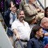 Sir Peter Jackson (centre) on the boarding steps with cast and crew of The Hobbit after the movie decorated boeing 777 - 300ER aircraft arrived in Wellington from Auckland this morning. Photo / Sarah Ivey