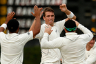 New Zealand's Tim Southee celebrates the wicket of Sri Lanka's Kumar Sangakkara during the second day of the second test cricket match between New Zealand and Sri Lanka. Photo / AP