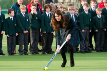 Kate, the Duchess of Cambridge, centre, plays hockey during her visit to St. Andrew's School. Photo / AP