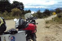 Charlotte Holmes' motorcycle with the backdrop of the Andean mountain ranges. Photo / Charlotte Holmes