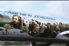 <p>Sir Peter Jackson and the Cast and crew of The Hobbit arrived at Wellington International Airport after flying on the Hobbit-themed Air NZ boeing 777 - 300ER aircraft. </p>