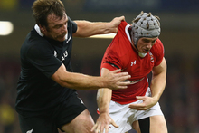 Jonathan Davies (R) of Wales spills the ball under the challenge of Andrew Hore (L) of New Zealand. Photo / Getty Images.