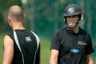 New Zealand's captain Ross Taylor, right, smiles as he looks at Chris Martin during a practice session. Photo / AP
